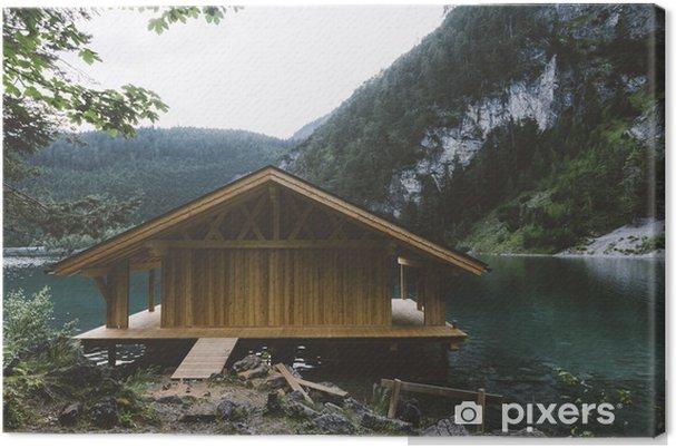 Canvas Houten huis op meer met bergen en bomen - Ontspanning