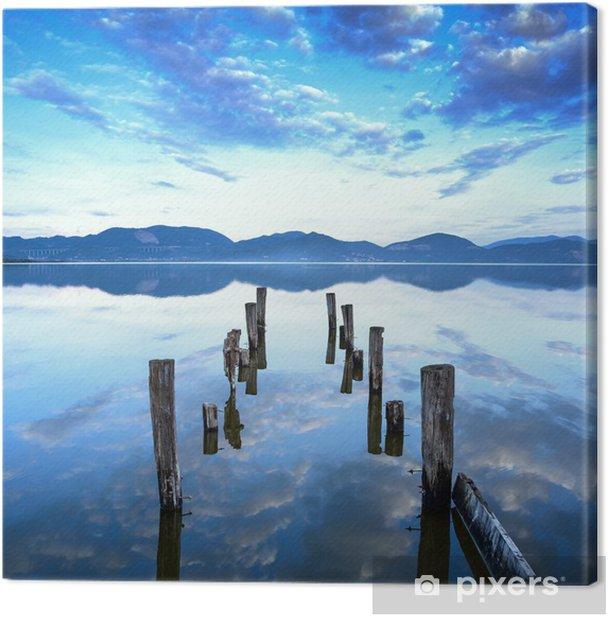 Canvas Houten pier of steiger blijft op een meer zonsondergang. Toscane, Italië - Thema's