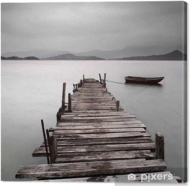 Canvas Kijkt uit over een pier en een boot, lage verzadiging -