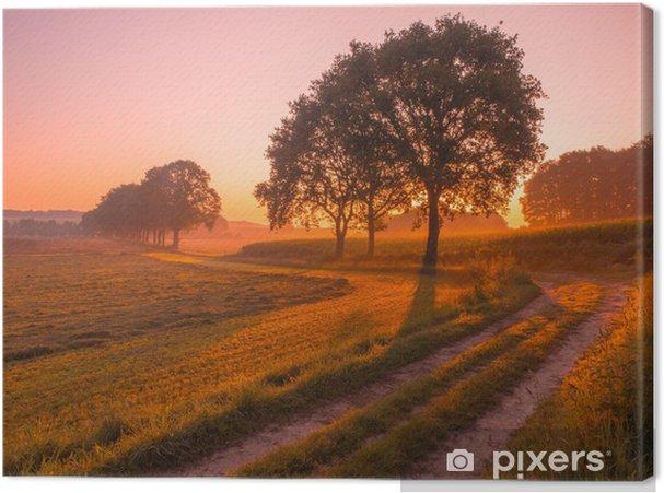Canvas Oranje en Roze Zonsopgang boven Landelijk Landschap in de buurt van Nijmegen - Seizoenen