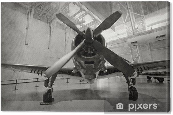 Canvas Oud vliegtuig in een hangar -