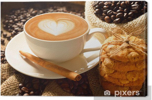 A cup of cafe latte with coffee beans and cookies Canvas Print - Themes