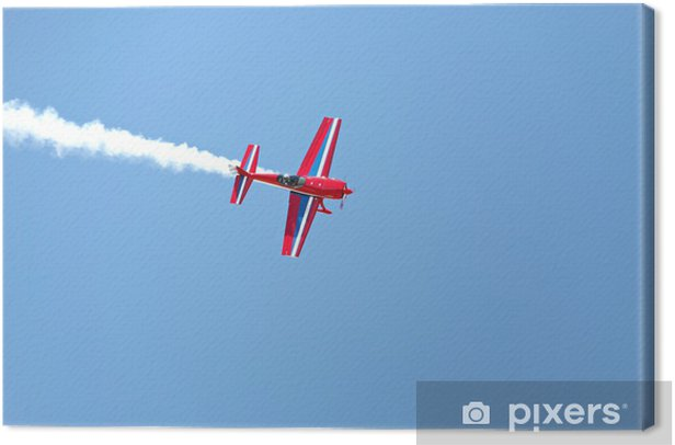 aerial acrobatics - red propeller plane with smoke blue sky Canvas Print - Themes