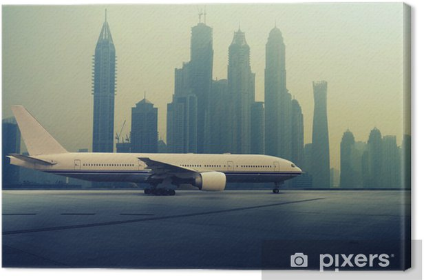 Airplane in front of a Skyline Canvas Print - Themes