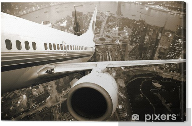 Airplane take off from the city Canvas Print -