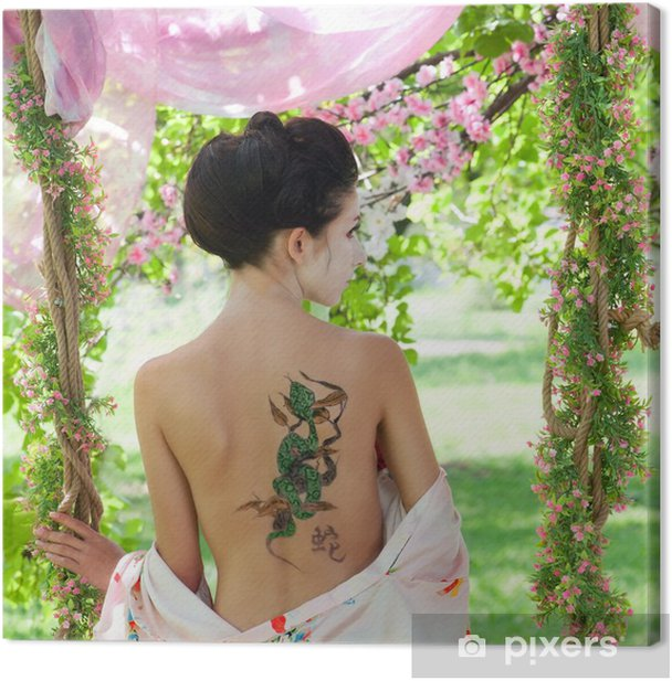 Asian style portrait of woman with snake tattoo on her back Canvas Print - Tattoos