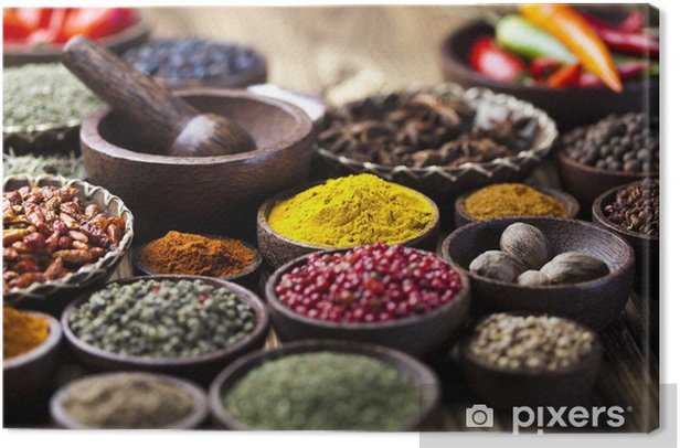 Assortment of spices in wooden bowl background Canvas Print - Themes