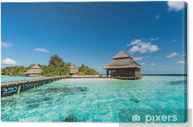 Beach Villas on small tropical island Canvas Print - iStaging