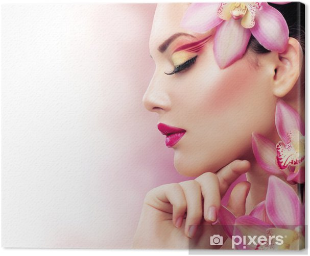 Beautiful Girl With Orchid Flowers. Perfect Make-up Canvas Print - Fashion