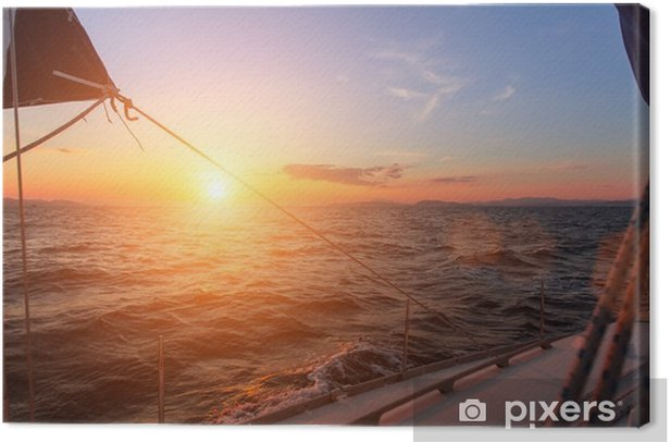 Beautiful sunset in the open sea with sailing yacht. Canvas Print - Landscapes