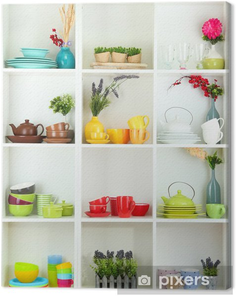 Beautiful white shelves with tableware and decor. Canvas Print - Themes