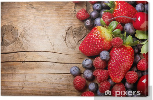Berries on Wooden Background. Organic Berry over Wood Canvas Print - Raspberries