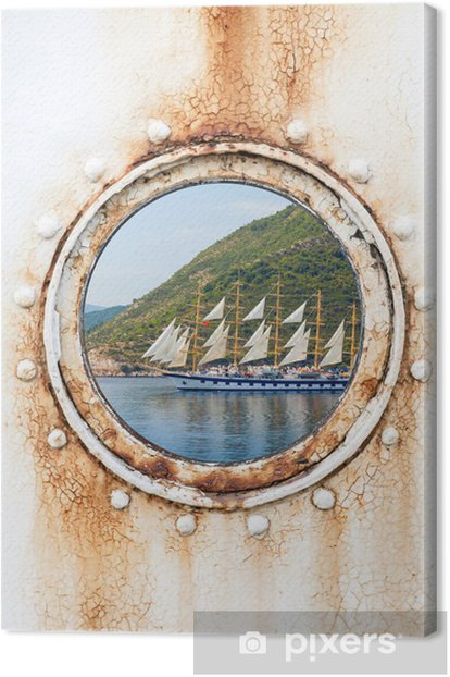 Big sailing ship behind round rusted porthole on white wall Canvas Print - Boats