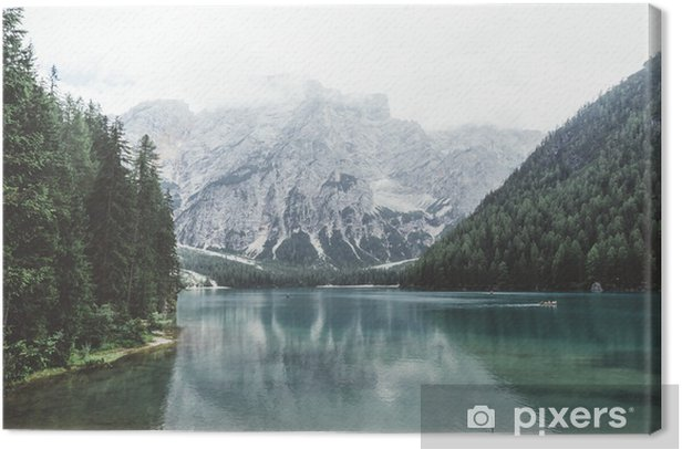 Braies lake with green water and mountains with trees Canvas Print - Relaxation