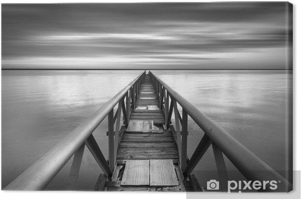 Bridge to the infinitive point over a sunset Canvas Print - Water