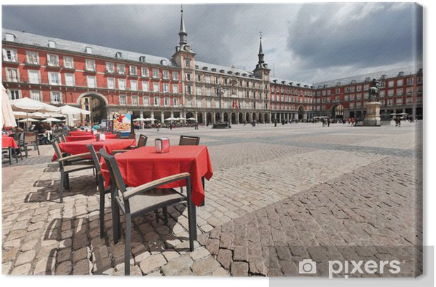 Cafe tables with red tableclothes in Plaza Mayor. Madrid. Canvas Print - European Cities