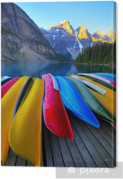 Canoes rest on the dock of Lake Moraine, Banff, Canada Canvas Print - Mountains