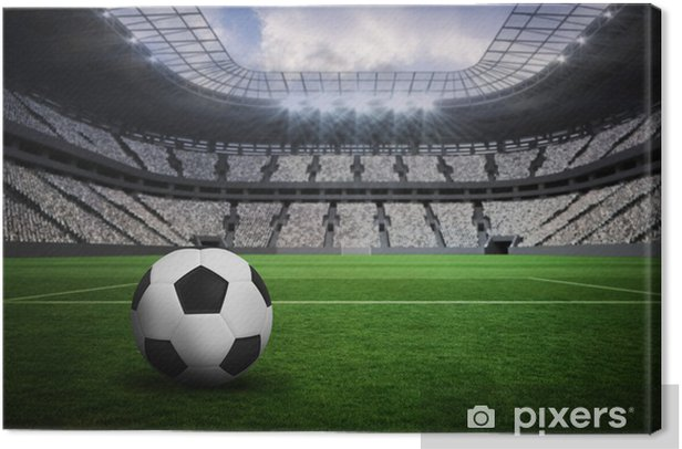 Composite image of black and white leather football Canvas Print - Sport