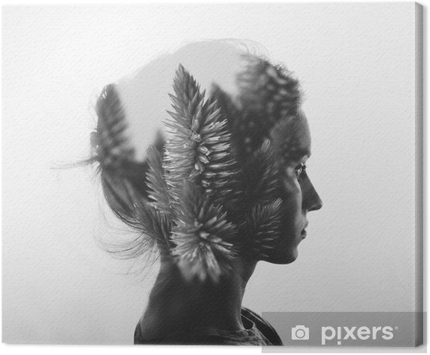 Creative double exposure with portrait of young girl and flowers, monochrome Canvas Print - People