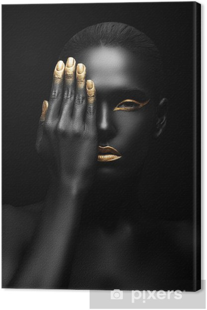 dark-skinned woman with golden make-up. Canvas Print -