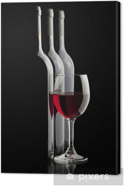 Elegant red wine glass and a wine bottles in black background Canvas Print - Themes