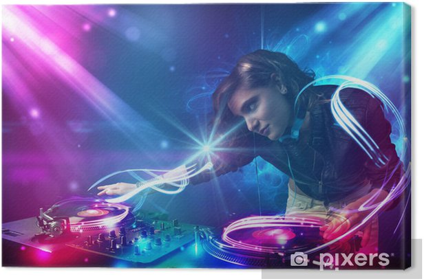 Energetic Dj girl mixing music with powerful light effects Canvas Print - Entertainment