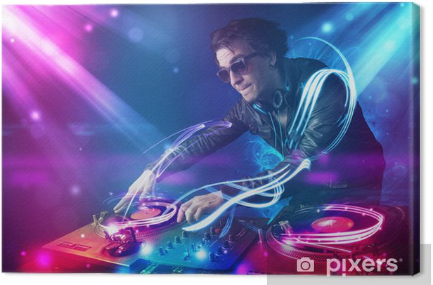Energetic Dj mixing music with powerful light effects Canvas Print - Entertainment