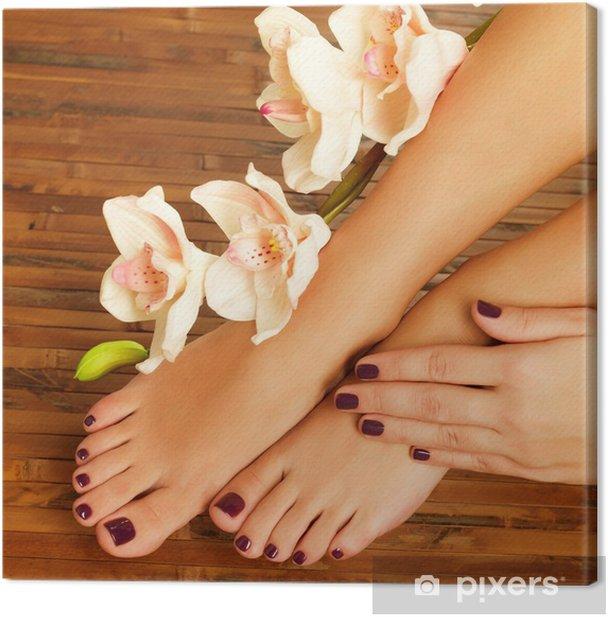 female feet at spa salon on pedicure procedure Canvas Print -