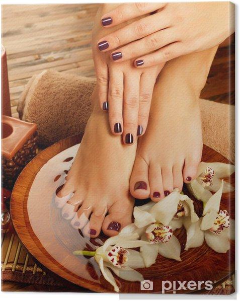 female feet at spa salon on pedicure procedure Canvas Print - Destinations