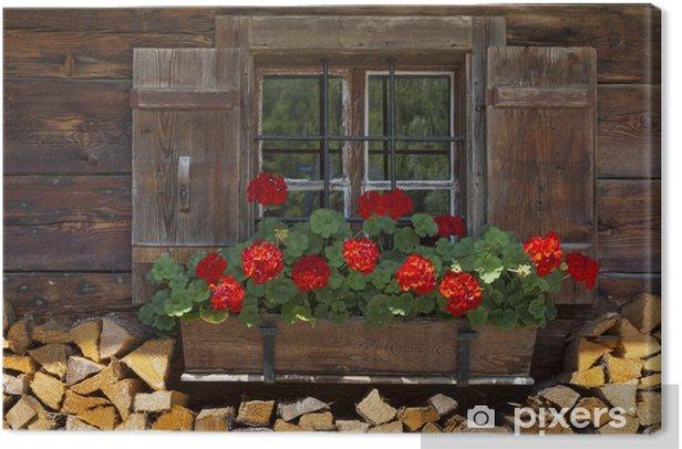 Fenster einer Almhütte mit Geranien und Holz Canvas Print - Holidays