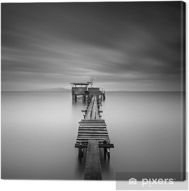 Fine art image of wooden fishing jetty at beach in black and white.Long exposure shot with motion blur. Canvas Print - Landscapes