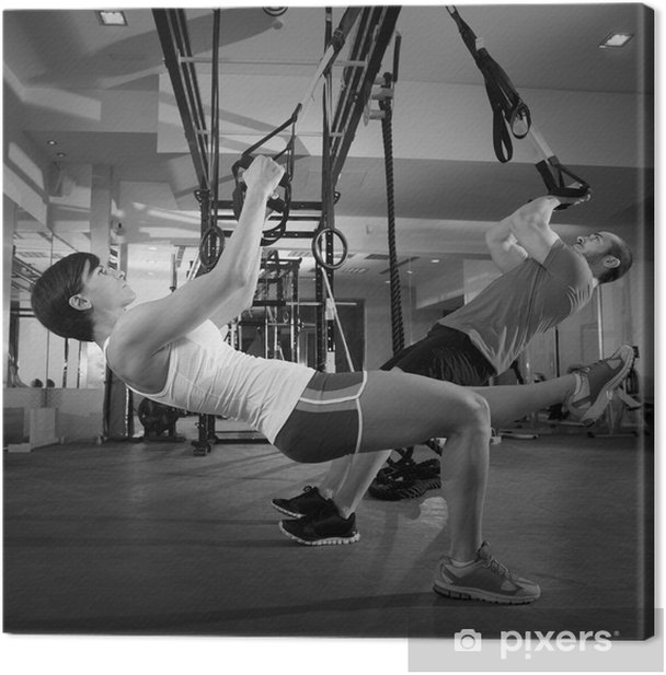 Fitness TRX training exercises at gym woman and man Canvas Print - Individual Sports