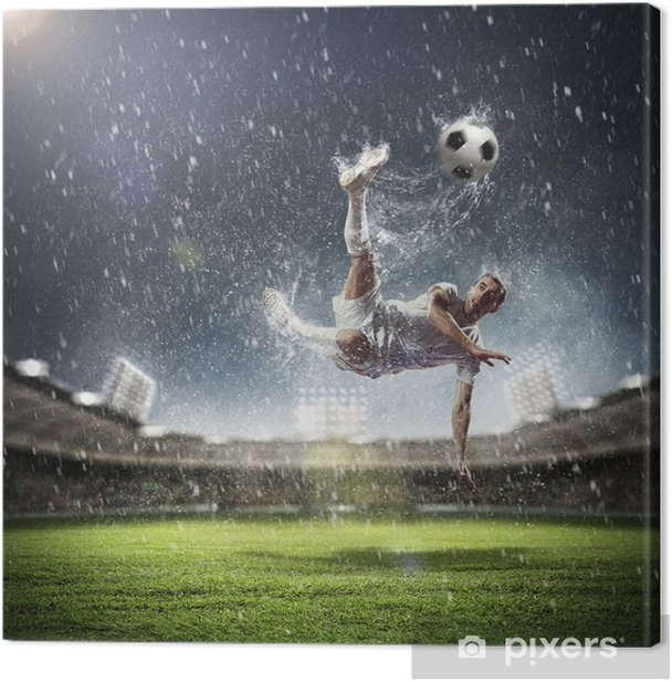 football player striking the ball Canvas Print - iStaging