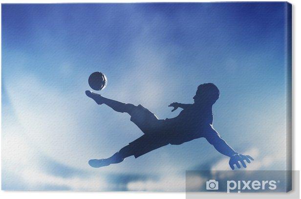 Football, soccer match. A player shooting on goal Canvas Print - Themes