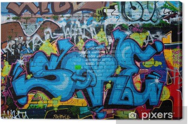 Graffiti detail on the textured brick wall Canvas Print - Themes