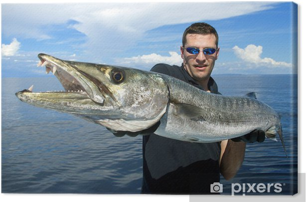 Happy fisherman holding a giant barracuda Canvas Print - Outdoor Sports