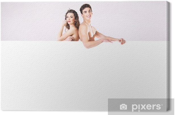 Happy young couple naked behind the board Canvas Print - Couples