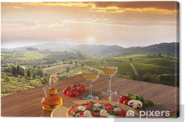 Italian pizza and glasses of white wine in Chianti, Italy Canvas Print -