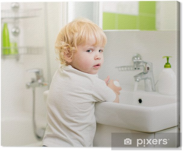 kid washing hands with soap in bathroom Canvas Print - Children