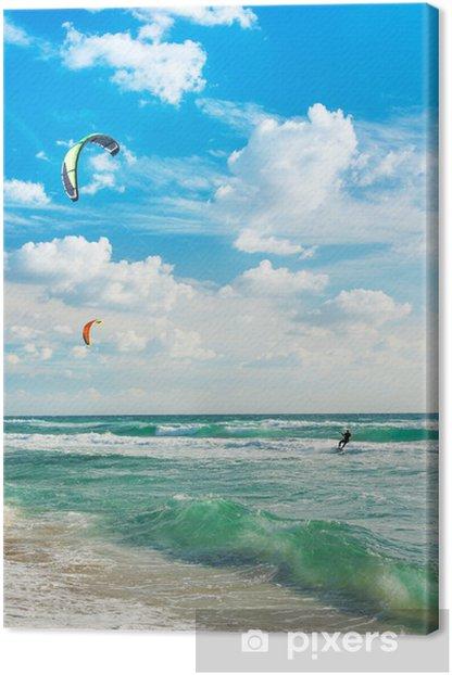 Kitesurfing. Kitesurfers rides the waves against sky. Canvas Print - Water Sports