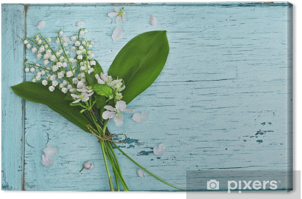 Lovely bouquet of lilies of the valley on a blue wooden table Canvas Print - Flowers