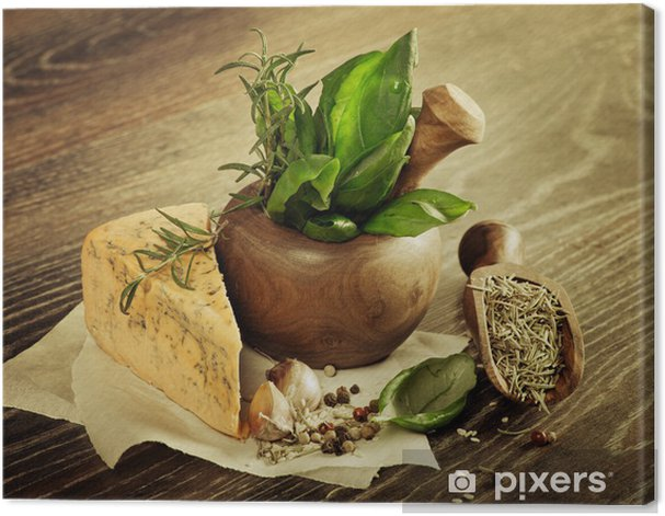 Macro composition of Italian cooking ingredients, garlic, rosema Canvas Print - Cheeses