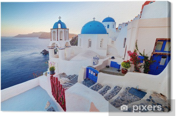 Oia town on Santorini island, Greece at sunset. Aegean sea. Canvas Print - Themes