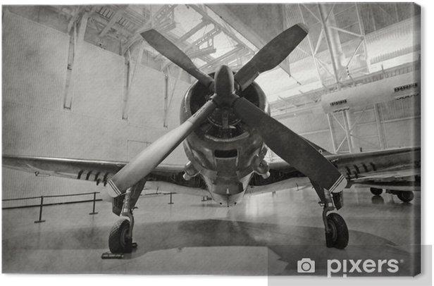 Old airplane in a hangar Canvas Print -