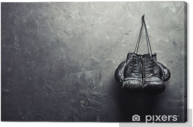 old boxing gloves hang on nail on texture wall Canvas Print - Themes