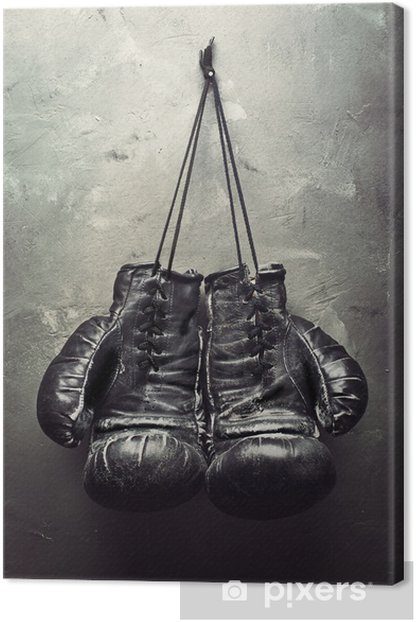 old boxing gloves hang on nail Canvas Print - Themes