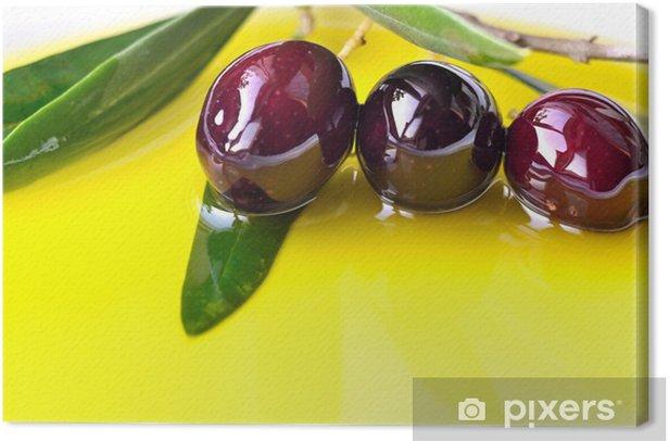 Olive oil background with black olives closeup Canvas Print - Olives