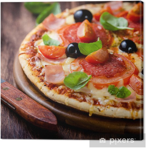 Pizza with salami, tomatoes and ham on wooden board Canvas Print - Themes
