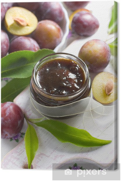 Plum jam in a glass jar and fresh fruits with leaves Canvas Print - Sweets and Desserts