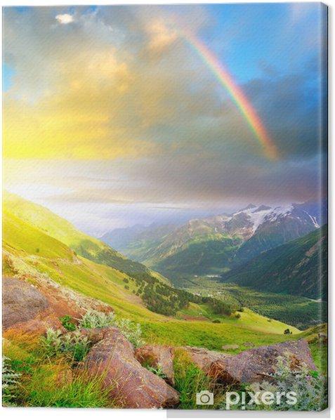Rainbow after rain in the mountain valley. Canvas Print - Rainbows